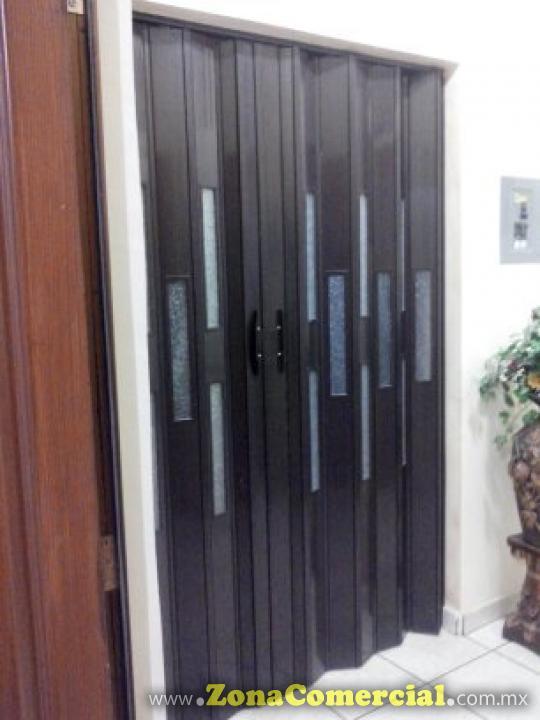 Puerta plegadizas